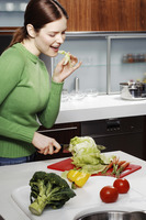 Woman cutting vegetables in the kitchen