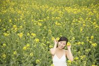 Woman decorating oilseed rape on her hair