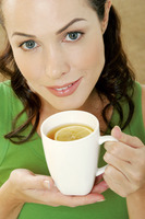 Woman drinking a cup of lemon tea