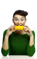Woman eating corn