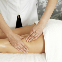 Woman enjoying a leg massage