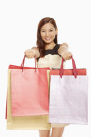 Woman handing out shopping bags