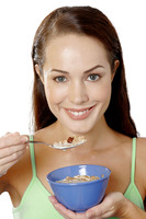 Woman having breakfast cereal