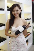 Woman holding a bottle of wine