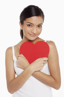 Woman holding a cut out heart shape