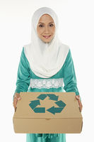 Woman holding a recyclable cardboard box