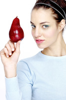 Woman holding a red pear