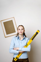 Woman holding a spirit level