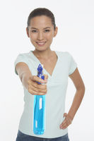 Woman holding up a spray bottle
