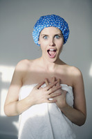 Woman in shower cap and towel screaming