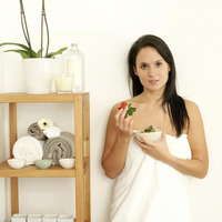Woman in towel holding a bowl of strawberries