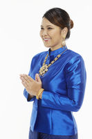 Woman in traditional clothing showing hand greeting gesture