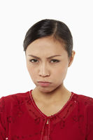 Woman in traditional clothing with a disappointed look