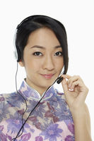 Woman in traditional clothing with a headset
