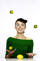 Woman juggling three limes