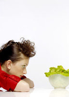 Woman looking at a bowl of salad