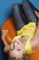 Woman lying on a chair smiling
