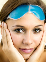 Woman putting on an eye mask