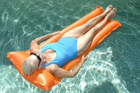 Woman relaxing on pool raft