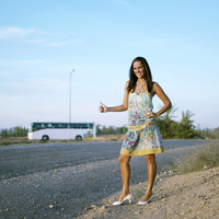 Woman showing a hitch hiking gesture