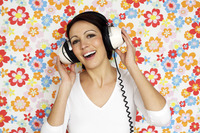 Woman singing while listening to music on the headphones