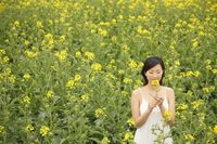 Woman smelling oilseed rape