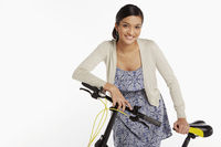 Woman standing beside a bicycle
