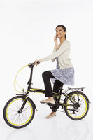 Woman talking on the phone while riding a bicycle