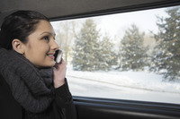 Woman talking on the phone while traveling in the car