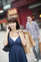 Woman with shopping bags talking on the phone