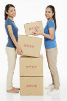 Women carrying a cardboard box