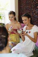 Women enjoying tea while listening to customer service representative's explanation