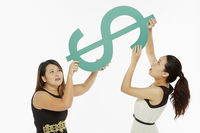 Women lifting up a dollar sign