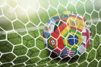 World flags soccer ball in goal net