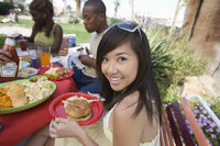Young woman at barbecue portrait