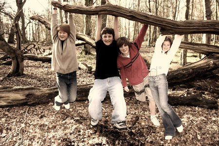 Children : A group of kids hanging out in the woods