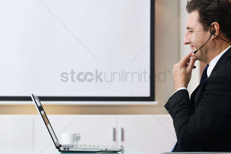 Business : Businessman video conferencing on laptop