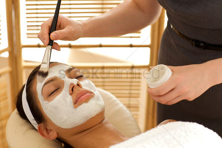 Spa : Close-up of young woman receiving beauty treatment in spa