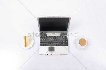 Concepts : Laptop with coffee and sandwich