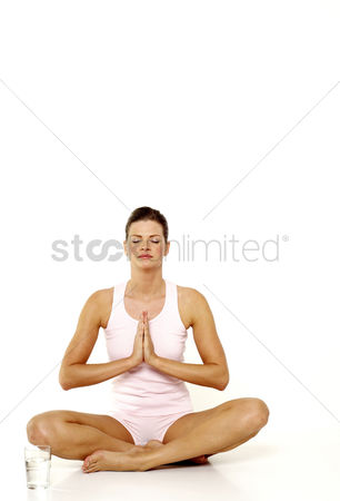 Water : Woman practicing yoga