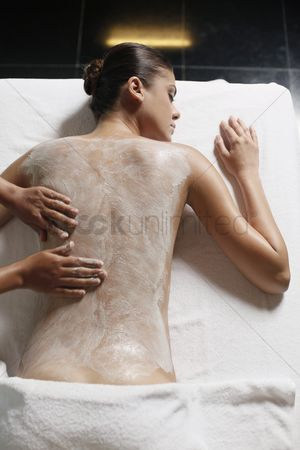 Spa : Woman receiving back massage with coconut scrub