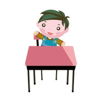 Boy sitting on a chair with desk