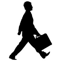 Businessman walking with briefcase silhouette