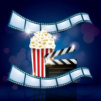 Popcorn and clapperboard with film rolls