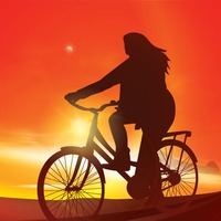 Silhouette of woman cycling