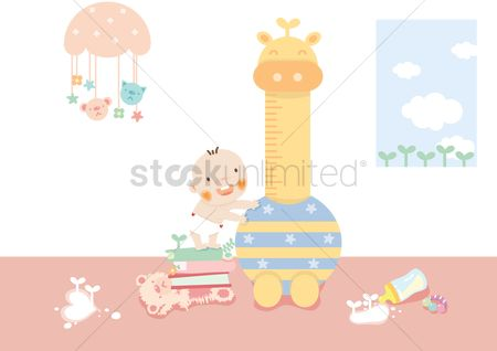 Play kids : Baby standing on a stack of books