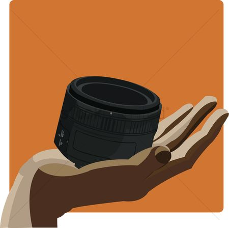 Background : Camera lens in hand