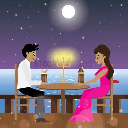 Dinner : Couple having candle light dinner