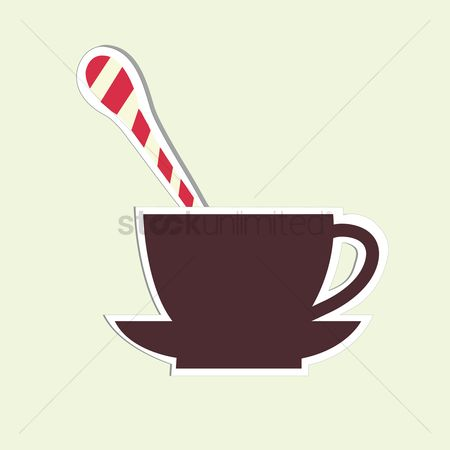 Background : Cup with a teaspoon on plain background