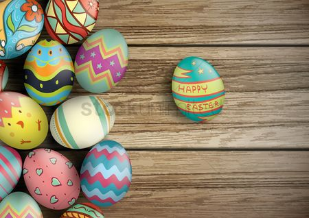 Greetings : Easter eggs on wooden board